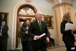 FILE - Senate Majority Leader Mitch McConnell, R-Ky., leaves the chamber after announcing an agreement in the Senate on a two-year, almost $400 billion budget deal, at the Capitol in Washington, Feb. 7, 2018.
