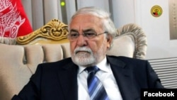 FILE - Sayed Fazlullah Wahidi, former governor of Afghanistan's western Herat province, arrived in Islamabad, Pakistan with his family to apply for a visa to visit Britain.