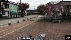 A bicycle is left near a station in the part of Minamisoma town that is inside the 20-kilometer evacuation zone in Fukushima Prefecture, Japan, April 21, 2011.