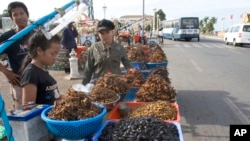 Cambodian vendors sell deep-fried crickets and bugs on a street in Phnom Penh, file photo.