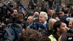 Firebrand int-islam lawmaker Geert Wilders, center, talks to media during his election campaign stop in Spijkenisse, near Rotterdam, Netherlands, Feb. 18, 2017.