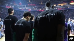 Boston Celtics players wear T-shirts in memory of Stephon Clark before the start of an NBA basketball game against the Sacramento Kings in Sacramento, Calif., Sunday, March 25, 2018.
