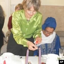 Andrea Barron lights the candles during Passover Seder at the ADAMS Center, a Virginia mosque.