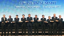 Heads of states and governments of the Association of Southeast Asia Nations pose for a group shot during the opening ceremony of the 18th ASEAN Summit in Jakarta, Indonesia, May 7, 2011.
