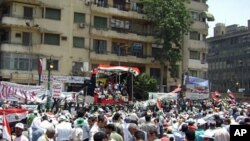 Protesters gather in front of a stage in Tahrir Square, July 15, 2011