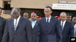 In this July 29, 2009 image made available by Kenya Presidential Press Services, Kenya's President Mwai Kibaki, left, Rwanda's President Paul Kagame, third left, and Burundi's President Pierre Nkurunziza, second left, and Zanzibar's President Dr. Abied Ka