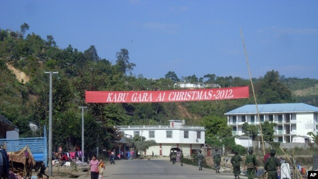 Soldiers of the ethnic Kachin Independence Army (KIA) patrol in downtown Laiza, northeastern Burma, January 4, 2013.