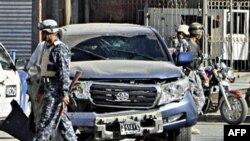 Nhân viên an ninh Iraq canh gác tại hiện trường sau một vụ nổ bom tại thủ đô Baghdad