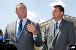 FILE - Rep. Jeff Denham, R-Calif., left, speaks next to Rep. David Valadao, R-Calif., during a news conference, May 9, 2018, on Capitol Hill in Washington. The Republican incumbents were swept out of office in 2018 after a tally of late-arriving ballots.