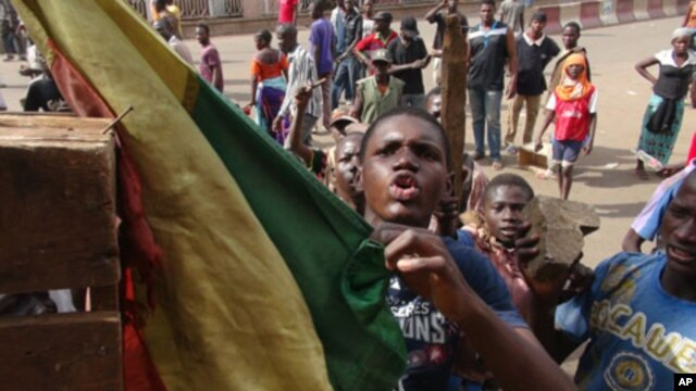Youths protest in front of national television headquarters in Bamako, Mali on Feb. 2, 2012. Protesters are angry about the government's handling of attacks by Tuareg rebels in north.