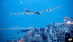 FILE - FILE - In this April 23, 2016 file photo, Solar Impulse 2 flies over San Francisco.