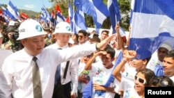 HK Nicaragua Canal Development Investment Co Ltd (HKND Group) Chairman Wang Jing greets youths during the start of work on the Interoceanic Grand Canal in Brito town, Dec. 22, 2014, in this handout provided by the Presidential Palace Nicaragua.