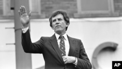 FILE - Then-Democratic presidential hopeful, U.S. Senator Gary Hart, waves goodbye, to a crowd of supporters in Springfield, Illinois, March 15, 1984. In 1988, Hart was considered a front-runner for the Democratic presidential nomination but a report alleging that he had an affair with model Donna Rice brought him down.