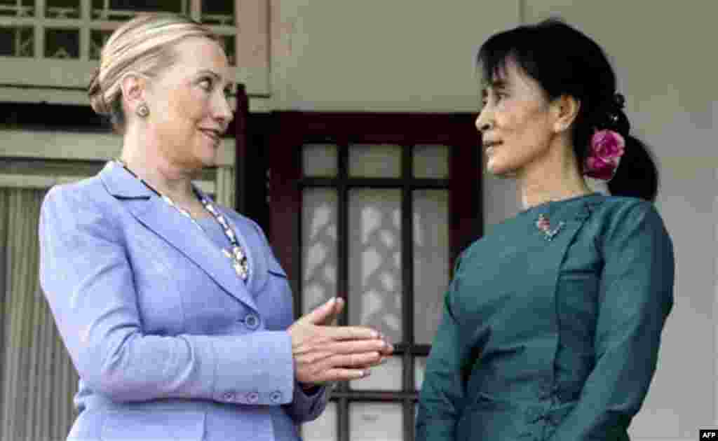 Myanmar's pro-democracy opposition leader Aung San Suu Kyi, right, talks with U.S. Secretary of State Hillary Rodham Clinton after a meeting at Suu Kyi's residence in Yangon, Myanmar, Friday, Dec. 2, 2011. U.S. Secretary of State Clinton and opposition le