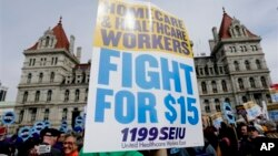 Supporters of a $15 minimum wage rally at the New York State Capitol in Albany on March 15, 2016. Supporters said an increase will boost salaries for women, who tend to earn less than men. (AP Photo/Mike Groll)