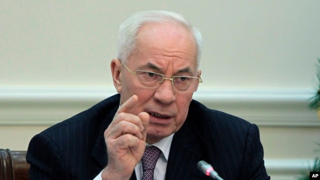 FILE - Ukrainian Prime Minister Mykola Azarov gestures while speaking during a cabinet meeting in Kiev, Ukraine, Wednesday, Dec. 18, 2013.