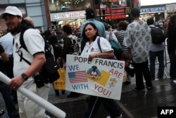 Pope Francis supporters gather outside of Madison Square Garden as he celebrates Mass on Sept. 25, 2015 in New York City.