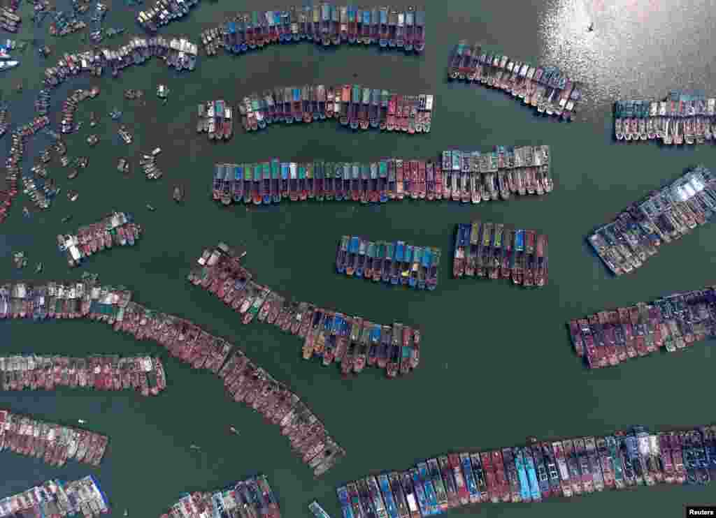 Fishing boats are parked in a port as Typhoon Nida approaches Guangzhou, Guangdong Province, China, Aug. 1, 2016.