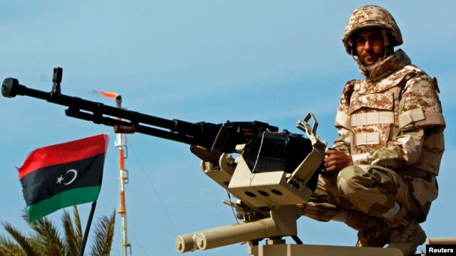 A member of the Libyan army is seen at the Mellitah Oil and Gas complex, west of Tripoli, March 4, 2013.