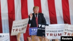"""U.S. Republican presidential candidate Donald Trump speaks at a campaign rally at Werner Enterprises Hangar in Omaha, Nebraska, May 6, 2016. Trump claims that with current trade deals the U.S. is """"losing a fortune to every country we do business with."""""""