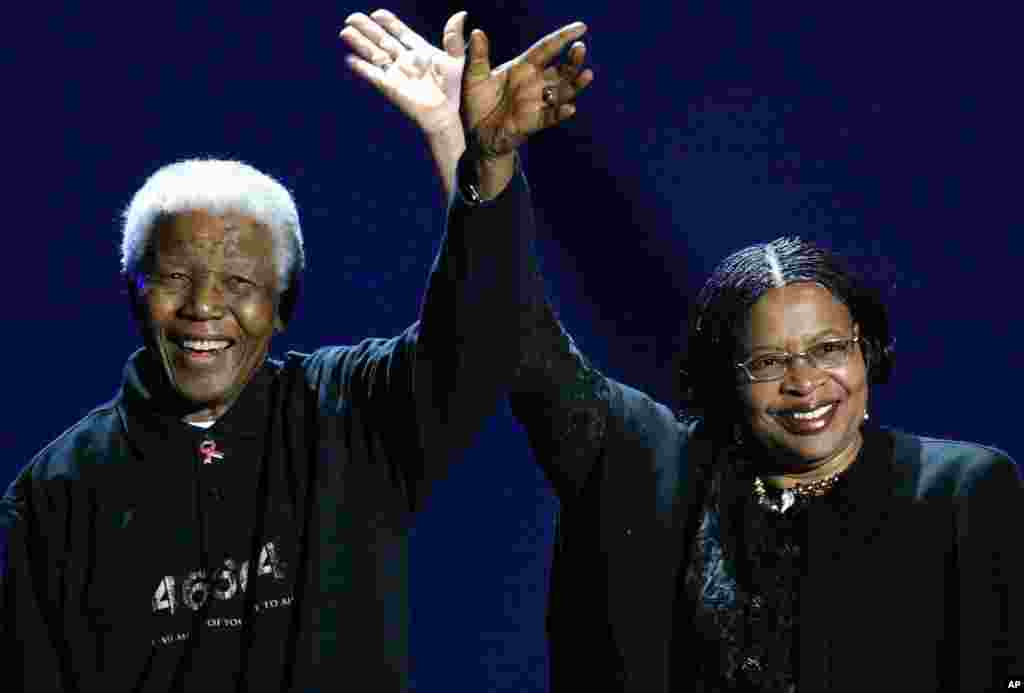 Nelson Mandela and his wife, Graca Machel, wave to the audience during a Live 8 concert in Johannesburg, July 2, 2005.