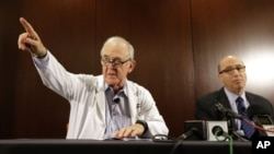 Dr. Edward Goodman, left, and Dr. Mark Lester at Texas Health Presbyterian Hospital Dallas, answer questions about an Ebola infected patient under their care, Sept. 30, 2014. (AP Photo/LM Otero)