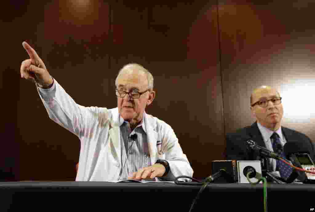 Dr. Edward Goodman (left) epidemiologist at Texas Health Presbyterian Hospital Dallas, takes a  question from a reporter as Dr. Mark Lester looks on during a news conference about their patient infected with the Ebola virus. The patient is the first person in the U.S. diagnosed with Ebola, in Dallas, Texas, Sept. 30, 2014.