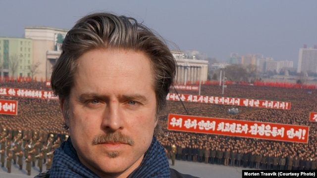Norwegian Director Morten Traavik in Pyongyang during a mass rally in Kim Il Sung Square on March 7, 2013.
