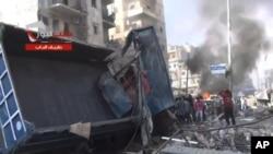 11月23日,叙利亚政府军对阿勒颇轰炸后的景象。