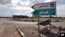 "A road sign pointing to the town of Tawergha, a former bastion of support for Moammar Gadhafi, has been painted over with ""Misrata,"" in Arabic, as part of score-settling following Libya's eight-month civil war."