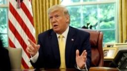 特朗普总统在白宫椭圆形办公室会晤中国副总理刘鹤。(2019年10月11日)