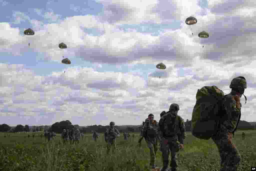 Parachutists jump from a plane near Groesbeek, Netherlands as part of commemorations marking the 75th anniversary of Operation Market Garden, an ultimately unsuccessful airborne and land offensive that Allied leaders hoped would bring a swift end to World War II.