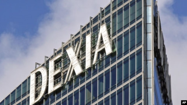 The logo of Belgian-French financial services group Dexia is seen on their building in the business district of La Defense, near Paris, October 7, 2011.