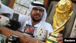 FILE -A mock-up of the World Cup is seen at a shop in Souk Waqif in Doha, Qatar, July 13, 2018.