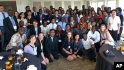 Group photo of participants, organizers, and US government officials at the welcoming lunch conference, in Washington, DC, August, 2011.