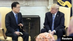 South Korea's national security chief Chung Eui-yong briefs U.S. President Donald Trump at the Oval Office about his visit to North Korea, in Washington, March 8, 2018.