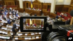 The rostrum of Ukraine's parliament is seen through a reporter's camera monitor in Kyiv, Sept. 17, 2015.