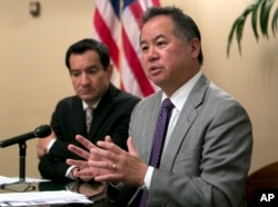 FILE - California Assemblyman Phil Ting, D-San Francisco, right, discusses the state budget in Sacramento, June 13, 2017. In 2016, Gov. Jerry Brown vetoed a bill by Ting that would have expanded the list of those who can seek gun violence restraining orders to include, among others, employees of high schools and colleges. The school shooting in Parkland, Fla., on Feb. 14, 2018, revived the debate about red flag laws. Ting said he plans to reintroduce the bill.
