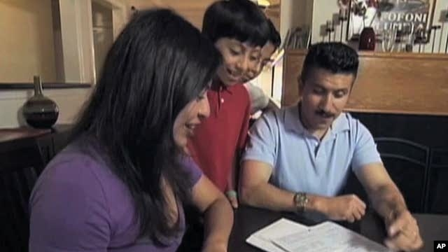 Latino-American family filling out census form