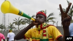 FILE - A Mali supporter gestures and blows a vuvuzela horn upon the arrival of Mali's team at Malabo airport, Jan. 16, 2015, ahead of the 2015 Africa Cup of Nations football tournament.