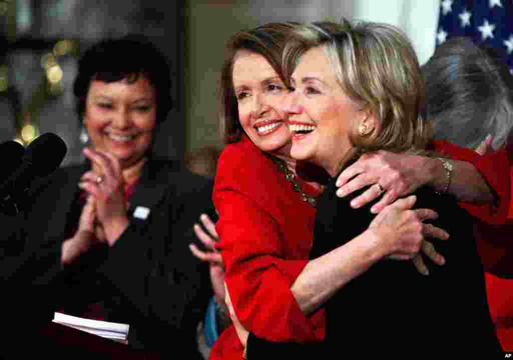 House Speaker Nancy Pelosi with Clinton in Statuary Hall on Capitol Hill in Washington, March 25, 2010, during the Women's History Month celebration. EPA Administrator Lisa Jackson applauds at left.