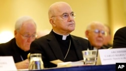 FILE - Archbishop Carlo Maria Vigano, Apostolic Nuncio to United States, listens to remarks at the United States Conference of Catholic Bishops' annual fall meeting, Nov. 16, 2015, in Baltimore.