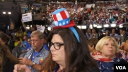 Delegates sport their hats at the DNC in Philadelphia (Photo: S. Barua/VOA)