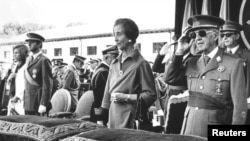 FILE - Former Spanish dictator General Francisco Franco salutes beside his wife Carmen Polo, the then Prince Juan Carlos of Spain and his wife Princess Sofia as they listen to the national anthem during a ceremony at El Pardo Palace, Oct. 4, 1975.
