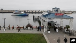 Commuters board a ferry to San Francisco Oct. 21, 2013, from Jack London Square in Oakland, California.
