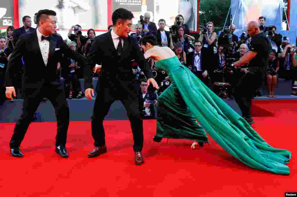 "A guest falls during the red carpet event for the movie ""The Light Between Oceans"" at the 73rd Venice Film Festival in Venice, Italy."