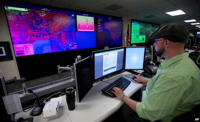 FILE - A specialist works at the National Cybersecurity and Communications Integration Center in Arlington, Virginia, Sept. 9, 2014.