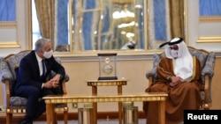 Wezîrê karên derve yê Îsraîlê Yair Lapid û Prensê Behreynê Şex Salman Bîn Hemîd El-Xalîfe li Manama, 30'yê Îlona 2021'an