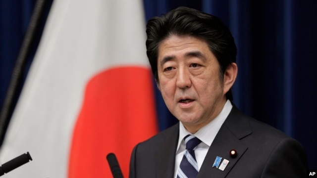 Japanese Prime Minister Shinzo Abe speaks during a news conference in Tokyo, Friday, March 15, 2013.