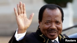 FILE - Cameroon's President Paul Biya departing meeting at Elysee Palace, Paris, Jan. 30, 2013.